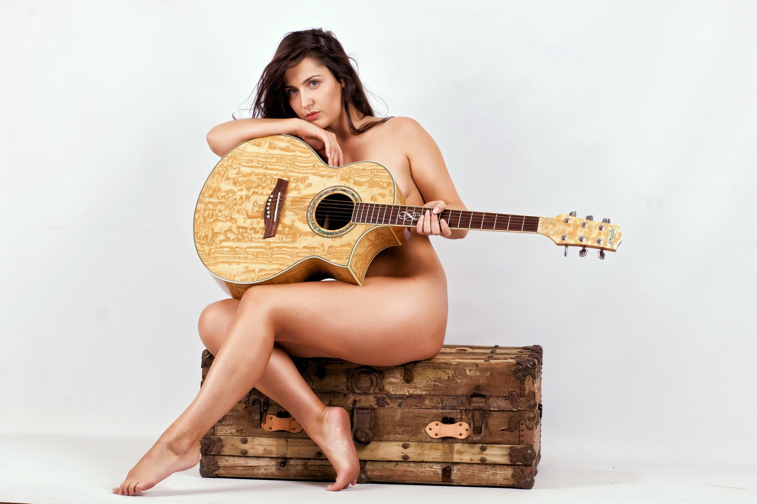 Nude girls with bass guitar