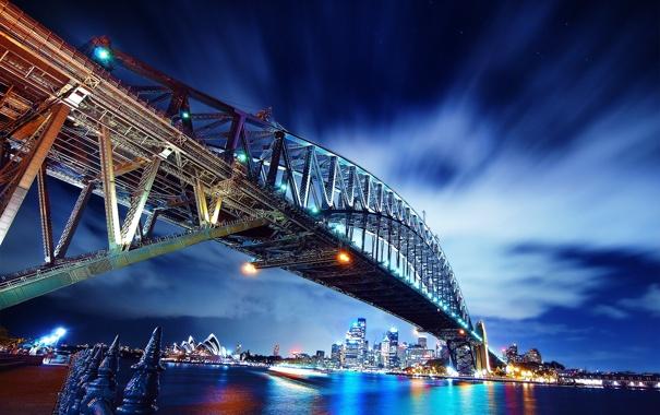 Фото обои небо, звезды, облака, мост, город, огни, вечер