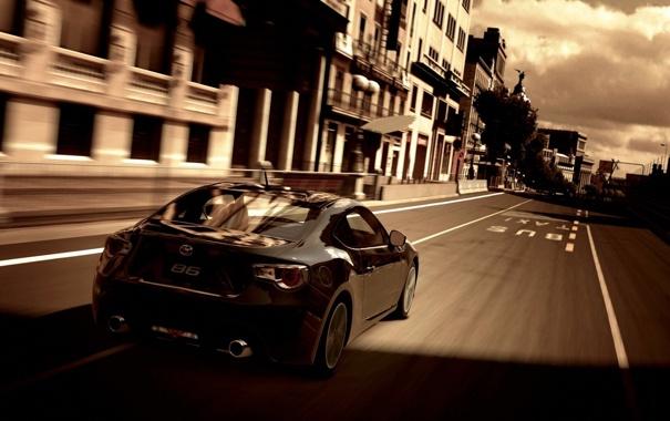 Фото обои дорога, облака, полосы, скорость, дома, черная, Toyota