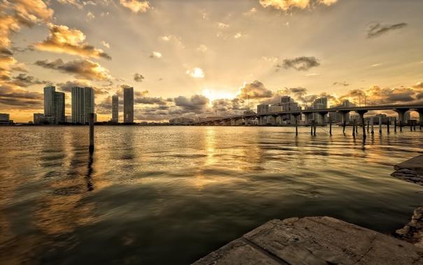 Фото обои облака, закат, мост, город, река, здания, дома