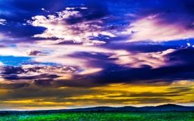 Обои поле, небо, трава, горы, тучи, зарево