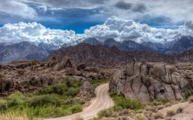 Картинка дорога, небо, горы, тучи, камни, скалы