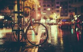 Обои ночь, велосипед, огни, улица, тень, тротуар, автомобили
