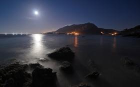 Обои море, свет, пейзаж, горы, ночь, огни, камни