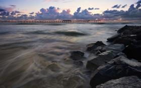 Картинка море, закат, тучи, камни, пирс