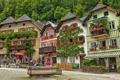 Картинка цветы, здания, Австрия, площадь, фонтан, Austria, Hallstatt