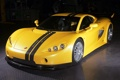 Картинка темно, гараж, желтая, чёрные полосы, Ascari, A10