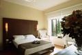 Картинка цветы, комната, кровать, интерьер, кресло, окно, ваза