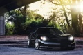 Картинка солнце, деревья, чёрный, Z06, Corvette, Chevrolet, шевроле