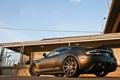 Картинка чёрный, Aston Martin, здание, DBS, матовый, ограждение, вид сзади