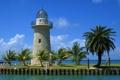 Картинка море, небо, облака, пальмы, маяк, пушка