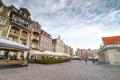 Картинка цветы, город, здания, дома, Польша, кафе, велосипеды